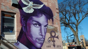 In this Jan. 29, 2018 photo, a painting of the late Prince is shown on a Minneapolis building. Fans remember Prince for his electrifying halftime performance at the Super Bowl in 2007. The 'Purple Rain' singer died in 2016, so his followers can only imagine how he might have topped that at this year's game in his hometown of Minneapolis. (AP Photo/Jeff Baenen)