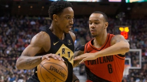 Toronto Raptors DeMar DeRozan (left) drives at Portland Trail Blazers Shabazz Napier during second half NBA basketball action in Toronto on Friday, February 2, 2018. THE CANADIAN PRESS/Chris Young