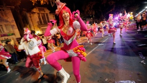 Members of the Pussyfooters dance at the Krewe of Cleopatra Mardi Gras parade in New Orleans, Friday, Feb. 2, 2018. Mardi Gras season is kicking into high gear with a slew of major parades throughout New Orleans. Although Carnival season officially began Jan. 6, the festivities really kick into high gear the two weekends ahead of Fat Tuesday. This year Fat Tuesday is Feb. 13.(AP Photo/Gerald Herbert)