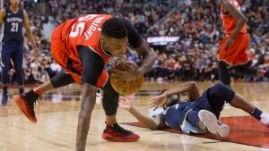 Toronto Raptors guard Delon Wright (55) collects a loose ball after wrestling with Memphis Grizzlies guard Wayne Selden (7) during second half NBA basketball action in Toronto on Sunday, February 4, 2018. THE CANADIAN PRESS/Chris Young