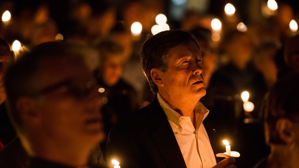 Toronto mayor John Tory attends a vigil hosted by the Metropolitan Community Church of Toronto, in Toronto on Sunday, February 4, 2018. A downtown Toronto neighbourhood came together to mourn the deaths of several men in the LGBTQ community at the hands of an alleged serial killer. THE CANADIAN PRESS/Christopher Katsarov