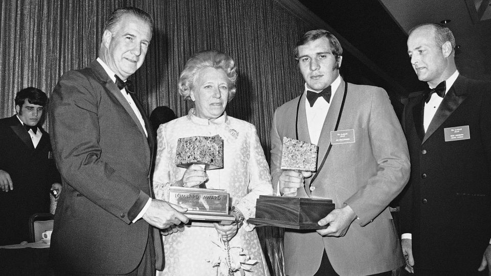 In this Jan. 22, 1971, file photo, Vice President Spiro Agnew, left, presents the first Lombardi Award to Ohio State defensive tackle Jim Stillwagon, second from right, in Houston. Stillwagon, who helped Ohio State win two U.S. college football titles before playing five seasons with the CFL's Toronto Argonauts, has died at the age of 68. THE CANADIAN PRESS/AP
