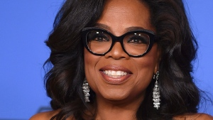In this Jan. 7, 2018 file photo, Oprah Winfrey poses in the press room with the Cecil B. DeMille Award at the 75th annual Golden Globe Awards in Beverly Hills, Calif. (Jordan Strauss / Invision / AP, File)