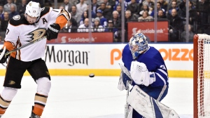Toronto Maple Leafs goaltender Frederik Andersen (31) makes a save in front of Anaheim Ducks centre Ryan Kesler (17) during first period NHL hockey action in Toronto on Monday, Feb. 5, 2018. THE CANADIAN PRESS/Frank Gunn