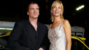 "In this Sept. 29, 2003 file photo, director of the film ""Kill Bill: Volume 1,"" Quentin Tarantino, left, and actress Uma Thurman arrive at the premiere of the film in Los Angeles. (AP Photo/Kevork Djansezian, File)"