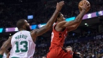 Toronto Raptors DeMar DeRozan goes to the basket past Boston Celtics Marcus Morris during second half NBA basketball action in Toronto on Tuesday, February 6, 2018. THE CANADIAN PRESS/Chris Young