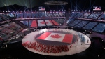 The team from Canada arrive on stage during the opening ceremony of the 2018 Winter Olympics in Pyeongchang, South Korea, Friday, Feb. 9, 2018. (AP Photo/Charlie Riedel)