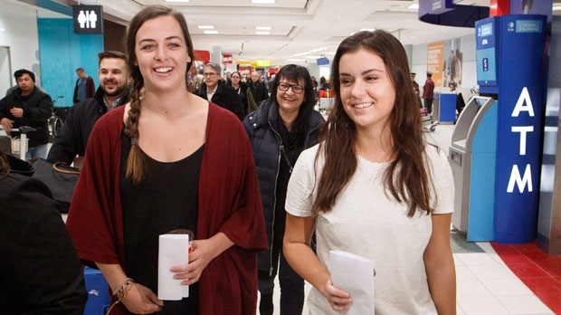 Eden Kazoleas, 19, right, and Jessica Drolet, 26, return to Canada after they were arrested on January 25 in Siem Reap, Cambodia, at Toronto Pearson International Airport in Mississauga, Ont., Friday February 9, 2018. THE CANADIAN PRESS/Mark Blinch