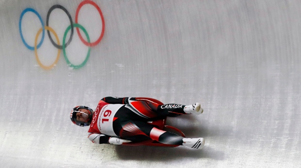 Sam Edney of Canada competes in the second round of the men's luge at the 2018 Winter Olympics in Pyeongchang, South Korea, Saturday, Feb. 10, 2018. (AP Photo/Andy Wong)