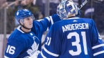 Toronto Maple Leafs' Mitchell Marner (left) celebrates with goaltender Frederik Andersen at the final buzzer after they defeated the Ottawa Senators in NHL hockey action in Toronto, on Saturday, February 10, 2018.THE CANADIAN PRESS/Chris Young