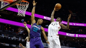 Toronto Raptors forward Pascal Siakam, of Cameroon, pulls in a rebound against Charlotte Hornets center Dwight Howard in the first half of an NBA basketball game in Charlotte, N.C., on Sunday, Feb. 11, 2018. Toronto won 123-103. (AP Photo/Nell Redmond)