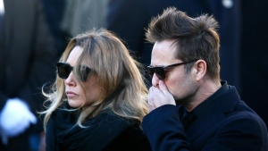 "Hallyday's daughter Laura Smet and son David Hallyday arrive at La Madeleine church for Johnny Hallyday's funeral ceremony in Paris. The lawyers of Laura Smet, the daughter of late French singer Johnny Hallyday say she will launch a legal challenge to contest her father's will which leaves all his property and artistic rights ""exclusively"" to his widow Laeticia. (AP Photo/Francois Mori, File)"