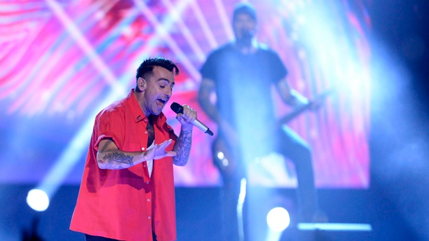 Jacob Hoggard of the band Hedley performs during WE Day Toronto celebrations on Thursday Sept. 28, 2017. THE CANADIAN PRESS/Nathan Denette