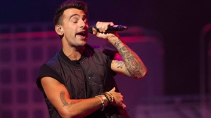 """Lead singer of Hedley, Jacob Hoggard, performs during """"We Day"""" in Toronto on Thursday, Oct. 2, 2014. THE CANADIAN PRESS/Hannah Yoon"""
