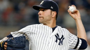 In this Monday, Sept. 18, 2017 file photo, New York Yankees starting pitcher Jaime Garcia delivers during the second inning of a baseball game against the Minnesota Twins in New York. Left-hander Jaime Garcia and the Toronto Blue Jays have agreed to a $10 million, one-year contract that includes a 2019 team option. Garcia gets $8 million this year as part of the deal announced Thursday, Feb. 15, 2018. (AP Photo/Kathy Willens, File)