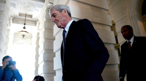 In this June 21, 2017, file photo, former FBI Director Robert Mueller, the special counsel probing Russian interference in the 2016 election, departs Capitol Hill following a closed door meeting in Washington. While the country waits to see if President Donald Trump will sit for an interview with prosecutors, scores of people sucked into the investigation are waiting for their own signal from special counsel Mueller: whether he's done with them or not.  (AP Photo/Andrew Harnik, File)