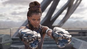"""This image released by Disney -Marvel Studios shows Letitia Wright in a scene from """"Black Panther."""" Actress Danai Gurira says the representation of women in the film is important for young girls to see. The film features a number of powerful female leads, including Gurira as the head of a special forces unit, Lupita Nyong'o as a spy, Angela Bassett as the Queen Mother and newcomer Wright as a scientist and inventor. (Matt Kennedy/Disney/Marvel Studios via AP)"""
