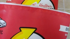 Adam Peddle says he has a growing collection of Tim Hortons Roll up the Rim cups, but they're not winners -- there's no message at all under the rim as shown in this handout image. (THE CANADIAN PRESS / HO-Adam Peddle)