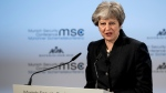 Britain's Prime Minister Theresa May speaks at the Security Conference in Munich, Germany, Saturday, Feb. 17, 2018. (Sven Hoppe/dpa via AP)