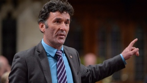 NDP MP Paul Dewar asks a question during Question Period in the House of Commons in Ottawa on September 29, 2014. A former NDP member of parliament says he underwent surgery after being diagnosed with brain cancer. Paul Dewar, 55, who represented Ottawa Centre from 2006 until 2015, says in a Facebook post that he was diagnosed with a brain tumour earlier this month after experiencing discomfort in his arm. THE CANADIAN PRESS/Adrian Wyld