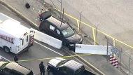 In this file image made from video and provided by WUSA TV-9, authorities investigate the scene of a shooting at Fort Meade, Md. on Wednesday, Feb. 14, 2018.  A passenger in the vehicle that was fired on outside the National Security Agency campus says the unlicensed teen driver made a wrong turn, panicked and hit the gas. Passenger Javonte Alhajie Brown said on Friday, Feb. 16,  that the 17-year-old driver was following GPS directions to reach a friend's house in a Maryland suburb. But he turned onto a restricted-access road that leads to the top-secret installation.  (WUSA TV-9 via AP)