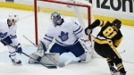Pittsburgh Penguins' Phil Kessel (81) can't get a shot past Toronto Maple Leafs goaltender Frederik Andersen (31) during the first period of an NHL hockey game in Pittsburgh, Saturday, Feb. 17, 2018. (AP Photo/Gene J. Puskar)