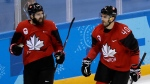 Eric O'Dell (22), of Canada, celebrates with Maxim Lapierre (40) after scoring a goal against South Korea during the second period of the preliminary round of the men's hockey game at the 2018 Winter Olympics in Gangneung, South Korea, Sunday, Feb. 18, 2018. (AP Photo/Matt Slocum)