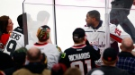 Washington Capitals right wing Devante Smith-Pelly (25) argues with Chicago Blackhawks fans from the penalty box during the third period of an NHL hockey game Saturday, Feb. 17, 2018, in Chicago. The Blackhawks won 7-1. (AP Photo/Jeff Haynes)