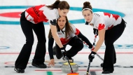 Canada's skip Rachel Homan, center, launches the stone during their women's curling match against Japan at the 2018 Winter Olympics in Gangneung, South Korea, Monday, Feb. 19, 2018. (AP Photo/Aaron Favila)