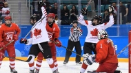 Canada players celebrate a goal against Olympic Athlete from Russia goaltender Valeria Tarakanova in women's third period hockey action at the 2018 Olympic Winter Games in Pyeongchang, South Korea, on Monday, February 19, 2018. THE CANADIAN PRESS/Nathan Denette