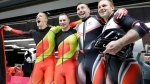 Francesco Friedrich, second from left, and Thorsten Margis, left, of Germany and Justin Kripps, right, and Alexander Kopacz of Canada celebrate after both teams tied for the gold medal during the two-man bobsled final at the 2018 Winter Olympics in Pyeongchang, South Korea, Monday, Feb. 19, 2018. (AP Photo/Wong Maye-E)