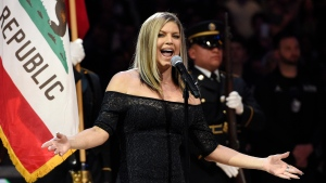 In this Sunday, Feb. 18, 2018, photo, Fergie performs the national anthem before the start of the NBA All-Star basketball game in Los Angeles. (AP Photo/Chris Pizzello)