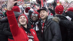 Toronto FC's Alex Bono (left) Jozy Altidore (centre) and Eriq Zavaleta pose for a selfie as they celebrate their victory in the MLS Cup final following a parade through downtown Toronto on Monday, December 11, 2017. oronto FC is hoping a short off-season will help carry the momentum from their MLS Cup championship into the round of 16 in the CONCACAF Champions League, which begins Tuesday in Colorado.THE CANADIAN PRESS/Chris Young