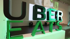 The logo for UberEATS is seen. (AP Photo/Lee Jin-man)