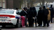 Family is seen gathering on a residential street in Brampton after a fatal shooting took place.
