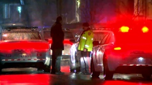 Police are seen on scene after a shooting took place in Brampton on Monday night.