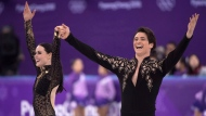 Canada's Tessa Virtue and Scott Moir salutes the crowd following their performance the ice dance figure skating short program at the Pyeongchang Winter Olympics Monday, February 19, 2018 in Gangneung, South Korea. THE CANADIAN PRESS/Paul Chiasson