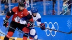 Canada forward Chris Kelly (11) and South Korea forward Kisung Kim (11) vie for control of the puck during first period men's hockey action at the 2018 Olympic Winter Games in Pyeongchang, South Korea, on Sunday, February 18, 2018. THE CANADIAN PRESS/Nathan Denette