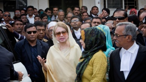 FILE- In this Dec. 28, 2017 file photo, Bangladesh's former prime minister and Bangladesh Nationalist Party (BNP) chairperson Khaleda Zia, center, leaves after a court appearance in Dhaka, Bangladesh. Zia appealed a five-year prison sentence in a corruption case on Tuesday, with her lawyers arguing that the verdict was politically motivated and influenced by the government. (AP Photo/A.M. Ahad, File)