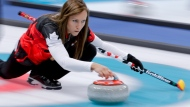 Canada's skip Rachel Homan throws a stone during a women's curling match against China at the 2018 Winter Olympics in Gangneung, South Korea, Tuesday, Feb. 20, 2018. (AP Photo/Natacha Pisarenko)