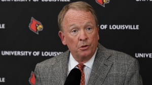 In this Sept. 29, 2017, file photo, interim University of Louisville President Greg Postel answers a question following the announcement of David Padgett as Louisville's interim men's basketball coach, in Louisville, Ky. Louisville must vacate its 2013 men's basketball title following an NCAA appeals panel's decision to uphold sanctions against the men's program for violations committed in a sex scandal. (AP Photo/Timothy D. Easley, FIle)