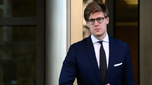 Alex van der Zwaan leaves Federal District Court in Washington, Tuesday, Feb. 20, 2018. (AP Photo/Susan Walsh)