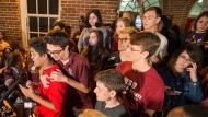 Marjory Stoneman Douglas High School survivors Tanzil Philip, left, is comforted by fellow student Diego Pfeiffer as Philip speaks to Leon High School students after arriving in Tallahassee, Fla., Tuesday, Feb 20, 2018. The students from Douglas High School are in town to lobby the Florida legislature after a shooting at their school by a former student that left more than a dozen students and faculty dead and others injured last week. (AP Photo/Mark Wallheiser)