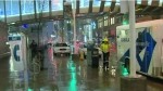 Police are investigating after a man smashed through a glass wall at the Eaton Centre.