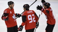 Canada defenceman Maxim Noreau (56)celebrates his goal against Finland with teammates Christian Thomas (92) and Chay Genoway (5) during men's third period Olympic quarterfinal hockey action at the 2018 Olympic Winter Games in Pyeongchang, South Korea on Wednesday, February 21, 2018. THE CANADIAN PRESS/Nathan Denette