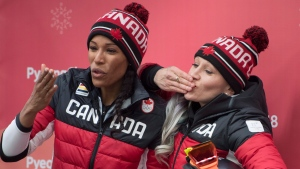 Canada's Kaillie Humphries and Phylicia George celebrate their bronze medal following women's bobsled at the Olympic sliding centre during the Pyeongchang 2018 Winter Olympic Games in South Korea, Wednesday, Feb. 21, 2018. THE CANADIAN PRESS/Jonathan Hayward
