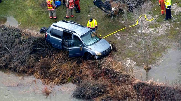 Crews inspect a van pulled from the Grand River after it was swept in with a three-year-old boy and his mother inside. While trying to get to safety, the boy was ripped from the mother's arms by the strong current and has not been found.
