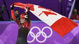 Kim Boutin, of Canada, celebrates after winning silver in the women's 1000-metre short-track speedskating at the 2018 Olympic Winter Games, in Gangneung, South Korea, Thursday, February 22, 2018. THE CANADIAN PRESS/Paul Chiasson