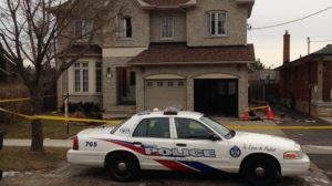 Officials are investigating the cause of a fatal house fire in Etobicoke. (Cam Woolley/ CP24)