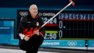 Canada's skip Kevin Koe reacts during a men's semi-final curling match against United States at the 2018 Winter Olympics in Gangneung, South Korea, Thursday, Feb. 22, 2018. (AP Photo/Natacha Pisarenko)